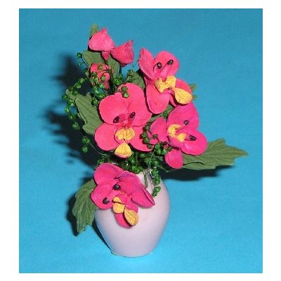 Red Flowers in Pink Vase